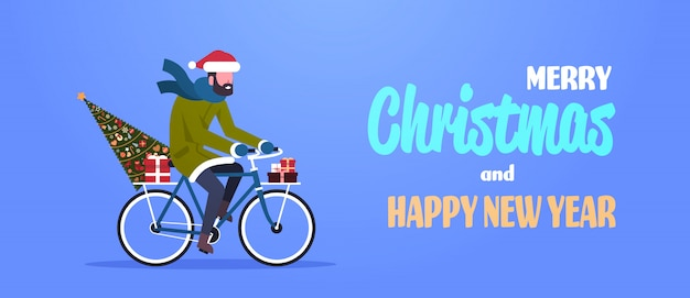 Man riding bike with fir tree gift box for christmas
