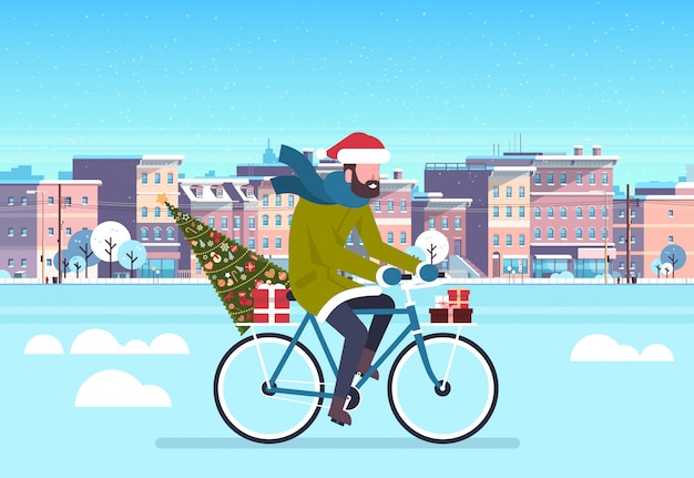 Man riding bike with fir tree gift box over city street buildings cityscape