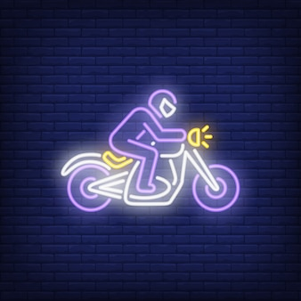 Man riding motorcycle on brick background. neon style