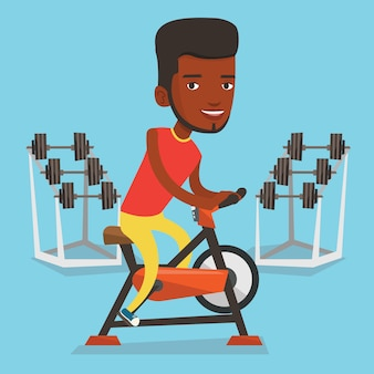 Man riding stationary bicycle  .