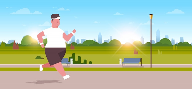 Man running  guy jogging outdoor city urban park weight loss concept