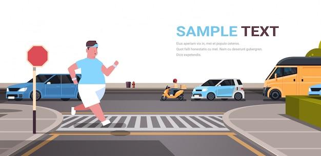 Man running  guy jogging outdoor crossing road on crosswalk city urban street weight loss concept