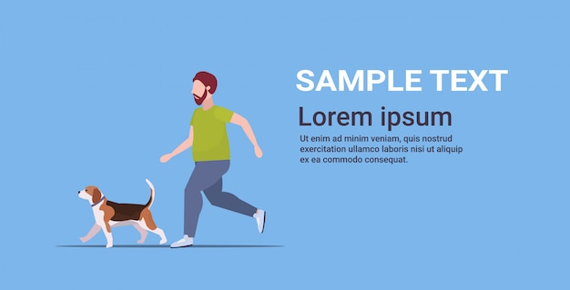 Man running with dog guy training workout weight loss concept  full length blue background horizontal copy space