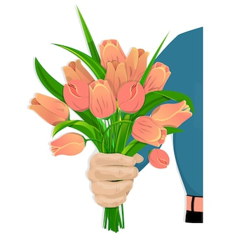 A man s hand gives a bouquet of red tulips.