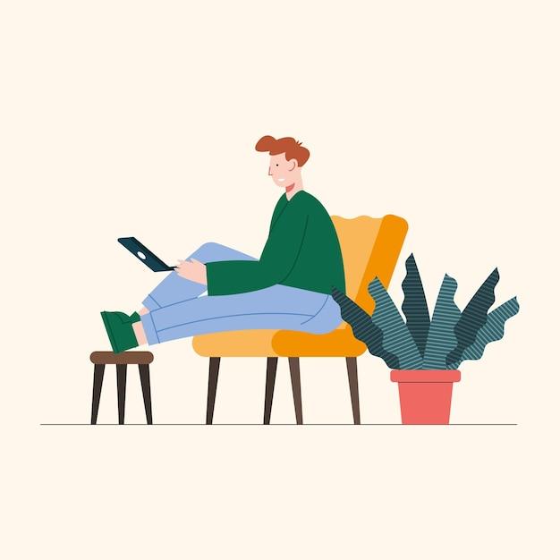 Человек сидит на диване с помощью ноутбука