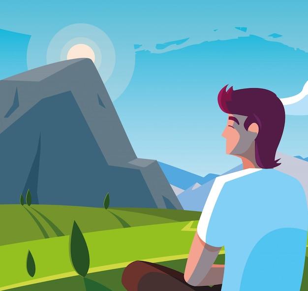 Человек сидит, наблюдая пейзаж горный