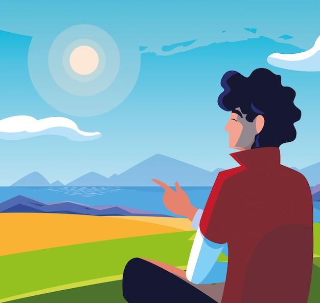 Человек сидит, наблюдая пейзаж с озером