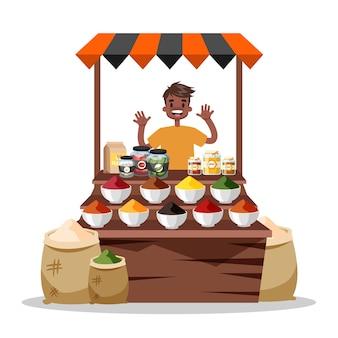 食品のスパイスを売る男。アジアのカラフルなスパイス市場