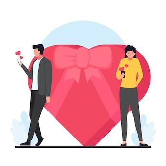 남자는 발렌타인 데이에 여자에게 사랑의 메시지와 큰 선물을 보냅니다.