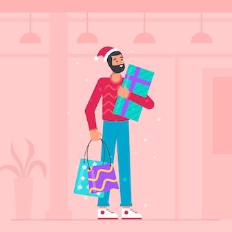 Человек делает покупки для рождественских подарков