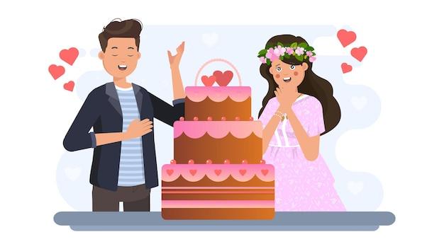 Мужчина показывает торт женщине на валентинке