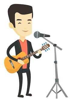 Человек петь в микрофон и играть на гитаре.