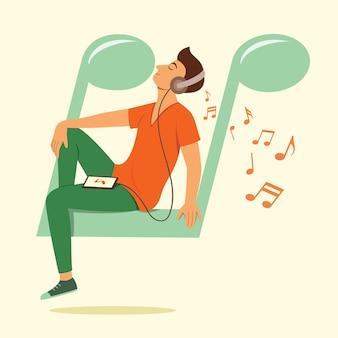 남자는 큰 음표 기호에 앉아 스마트 폰에서 노래를 듣습니다.