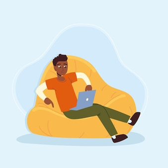 Man sits on bean bag with