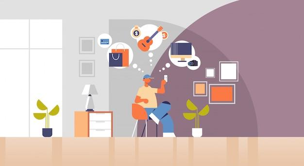 Man sitting on armchair guy holding smartphone using online mobile application online shopping digital technology concept modern living room interior flat full length horizontal