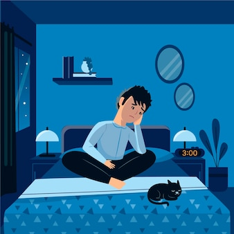 Man sitting in bed with cat