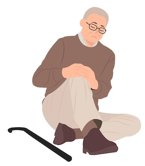 Man sitting on the floor and holding his painful knee
