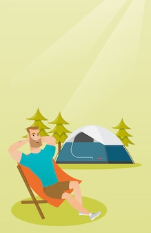 Man sitting in a folding chair in the camping