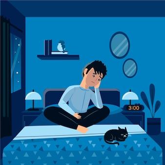 Человек, сидящий в постели с кошкой