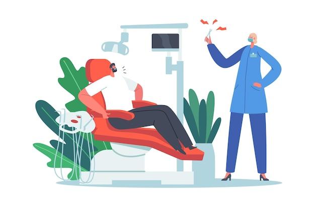 口腔科医の内閣の医療椅子に座っている男性は、歯科治療の前に恐怖を感じます。医師による歯の健康診断