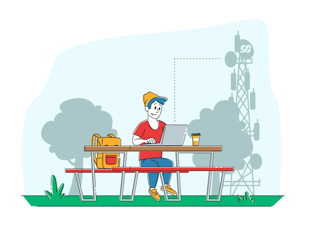 伝送通信塔の机の上のラップトップでベンチに座っている男