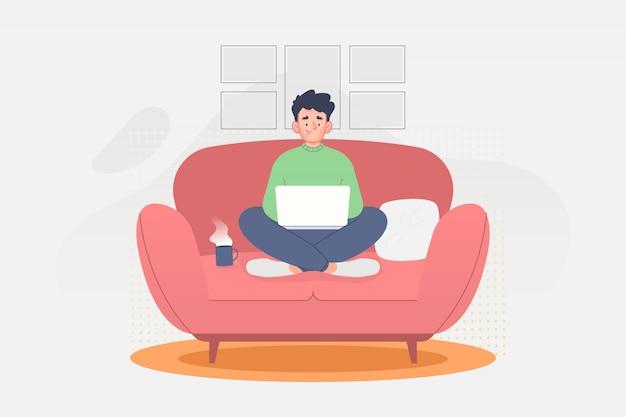 Человек сидит на диване и работает с ноутбуком