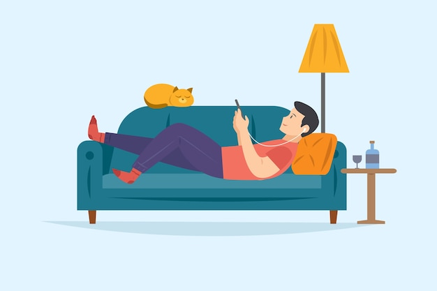 Man on the sofa relaxing while listening to music on smartphone