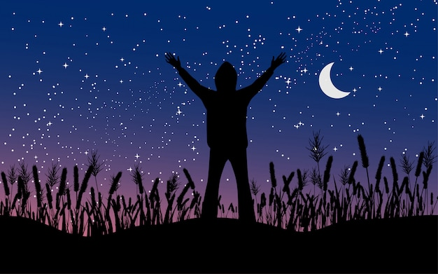 Man standing alone in grass with moon and sky full of stars
