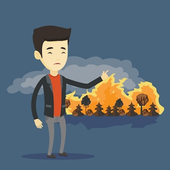 Man standing on the background of wildfire.