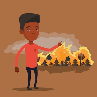 Man standing on background of wildfire.