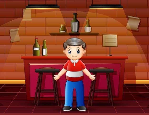 A man standing near the bar counter