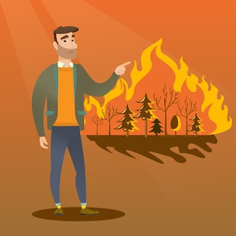 Man standing on the wildfire.