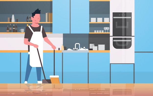 빗자루와 국자 젊은 남자가 집안일 집 청소 개념 현대 부엌 인테리어 남성 만화 캐릭터를하고 바닥 청소
