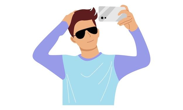 男はカメラ付き携帯電話で自分撮りをします