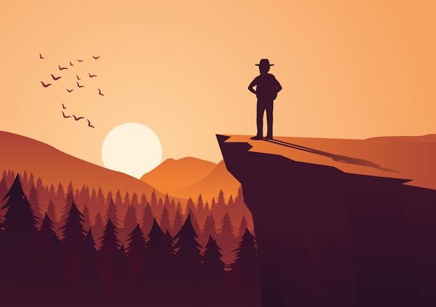 人はジャングルで冒険をし、崖の上に立つ