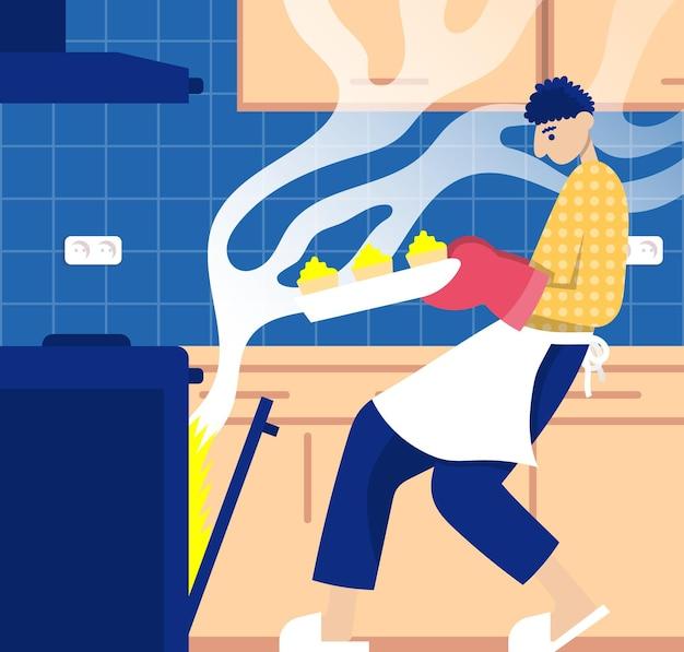 Мужчина достает кексы из духовки процесс приготовления пищи в интерьере кухни пищевой блоггер