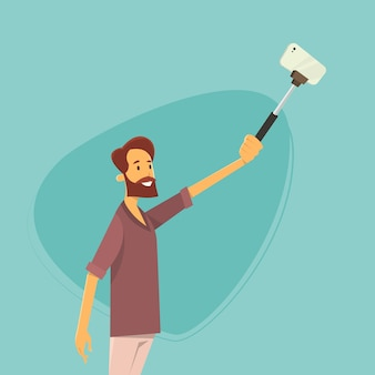 Man taking selfie photo on smart phone with stick