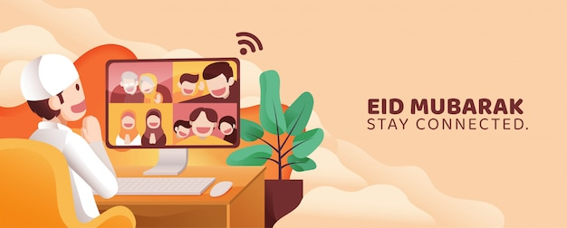 Man teleconference call with his family and friends in eid mubarak al fitr from home in front of pc monitor full of happiness. stay connected during covid-19 quarantine.