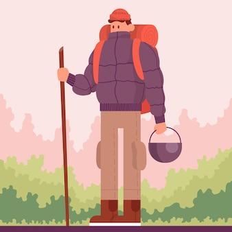 森の中でバックパックを持ってトレッキングを旅行する男性屋外ハイキングのコンセプト