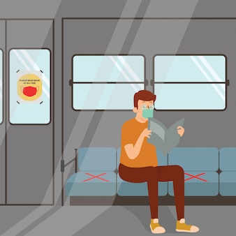 A man using commuter to go somewhere while keep using medical mask