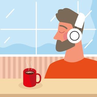커피와 함께 이어폰을 사용하는 남자