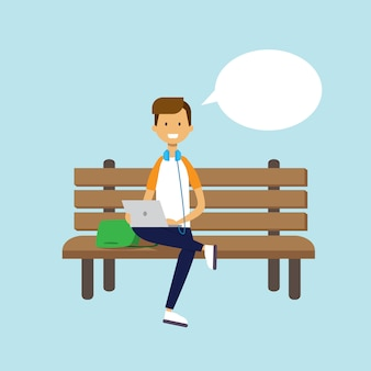 Man using laptop sitting wooden bench chat bubble character full length over blue background flat