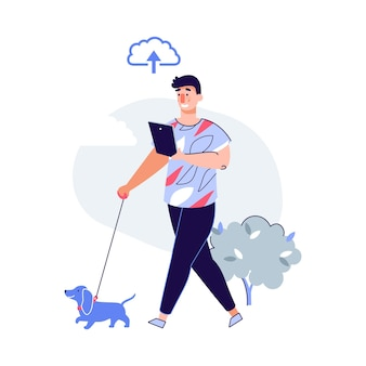 犬の散歩とオンラインクラウドストレージアイコンでデバイスを見ている