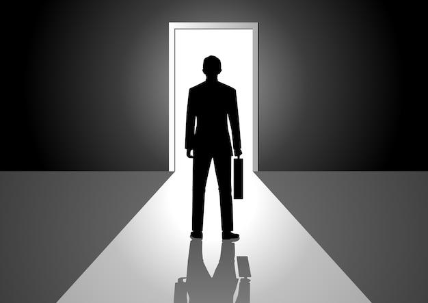 Man walking into a bright door