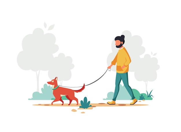 Man walking with dog in the park. outdoor activity
