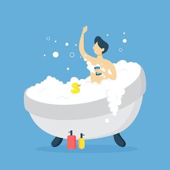 Мужчина моется в ванне и играет с уткой.