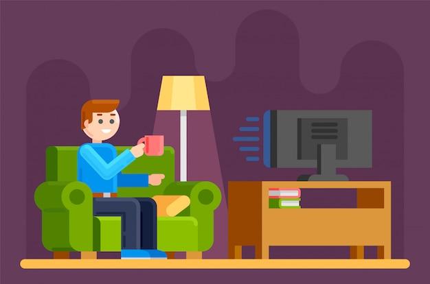 男はソファでテレビを見る