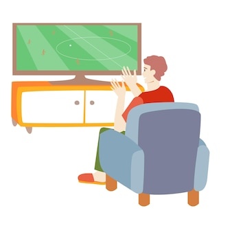 Man watching tv the guy sits on a chair and watches football living room interior selfisolation