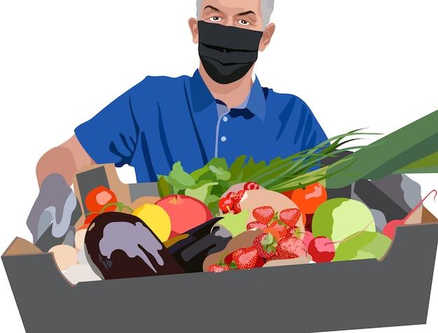 青いtシャツ、サージカルマスク、イチゴ、トマト、チェリー、ネギ、ザクロ、大根、レタスで満たされた箱を保持している手袋を身に着けている男