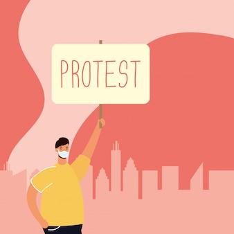 プラカードのイラストに抗議する医療マスクを着た男